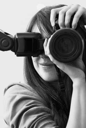 Girl with a camera in black and white, self portrait
