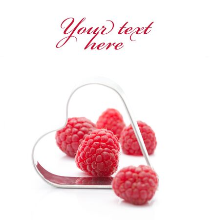 Fresh raspberries with metallic heart (easy removable text)