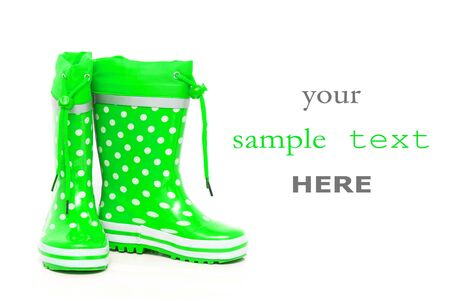 wellie: Green rubber boots for kids isolated on white background (with space for text) Stock Photo