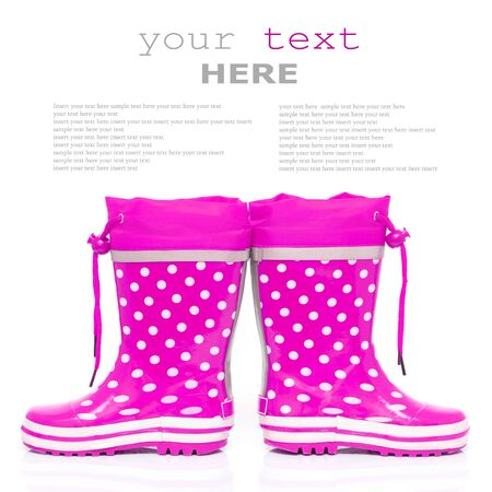 wellie: Pink rubber boots for kids isolated on white background (with sample text)