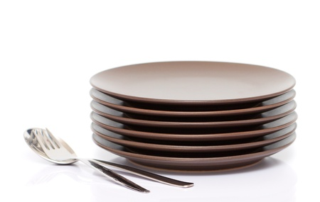 A stack of plates with fork and spoon