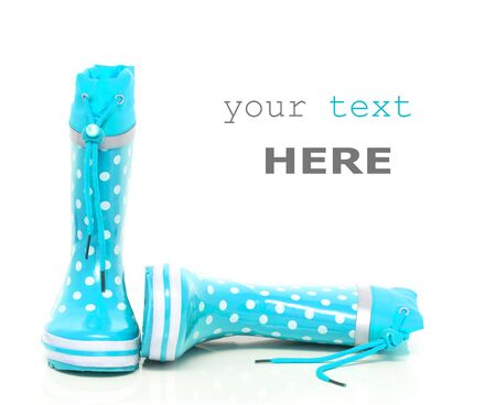 wellie: Cyan rubber boots for kids isolated on white background (with space for text)
