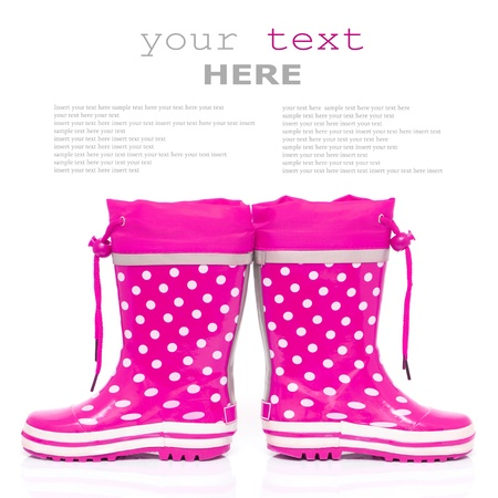 Pink rubber boots for kids isolated on white background (with sample text) photo