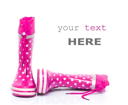 Pink rubber boots for kids isolated on white background (with space for text)