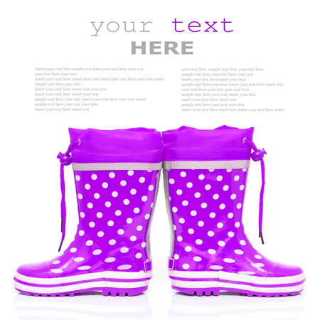 wellie: Purple rubber boots for kids isolated on white background (with sample text)