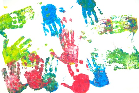 Brightly colored hands print on white background