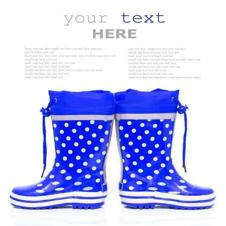 wellie: Blue rubber boots for kids isolated on white background  with sample text