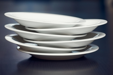 A stack of white plates on a table Stock Photo
