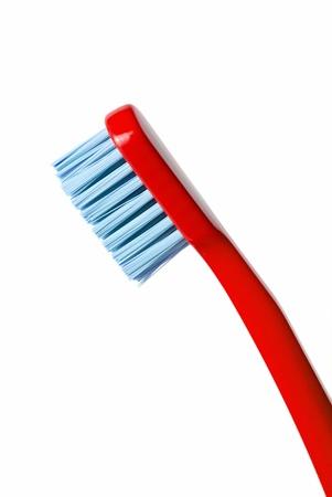 diagonally: Colored toothbrush diagonally isolated on white background