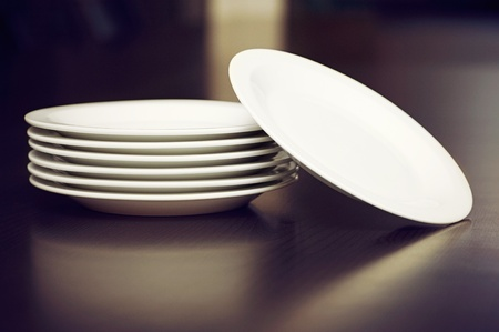 Stack of white plates on a table photo