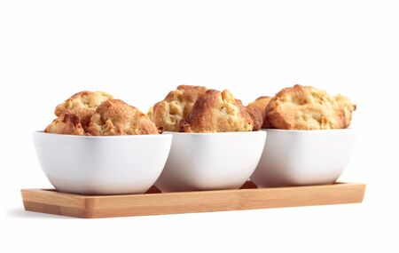 Freshly baked homemade apple cookies in three white bowls photo