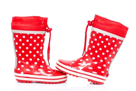 Red rubber boots for kids isolated on white background  with space for text