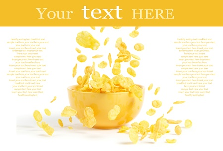 Golden cornflakes falling into the breakfast bowl Stock Photo