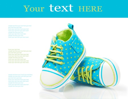 blue spotted: Baby sneakers on white with sample text Stock Photo