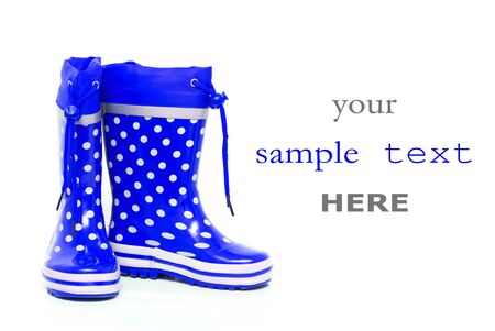 wellie: Blue rubber boots for kids isolated on white background  with space for text