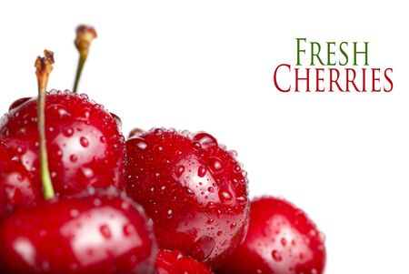 Fresh cherry berries closeup with drops, isolated on white photo