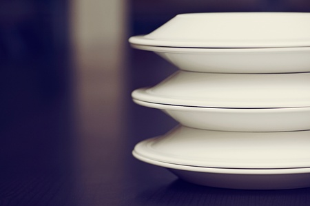 White plates on a table photo