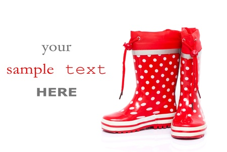 wellie: Red rubber boots for kids isolated on white background (with space for text)