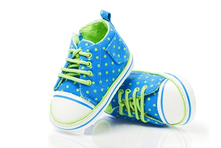 cute shoes: Spotted baby sneakers closeup isolated on white Stock Photo