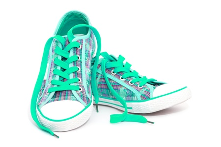 Closeup of cyan sneakers with shoelaces isolated on white background photo
