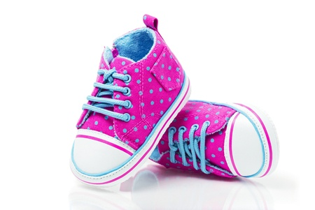 Spotted baby sneakers closeup isolated on white Stock Photo