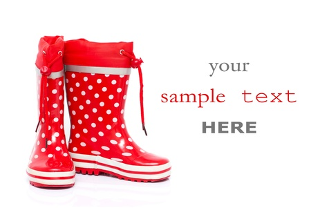 Red rubber boots for kids isolated on white background (with space for text) photo