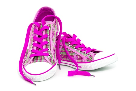 tennis shoe: Closeup of pink sneakers with shoelaces isolated on white background Stock Photo
