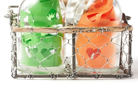 Bottles with hearts in wired basket photo