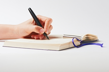 Hand with pen on white background Stock Photo - 16262580