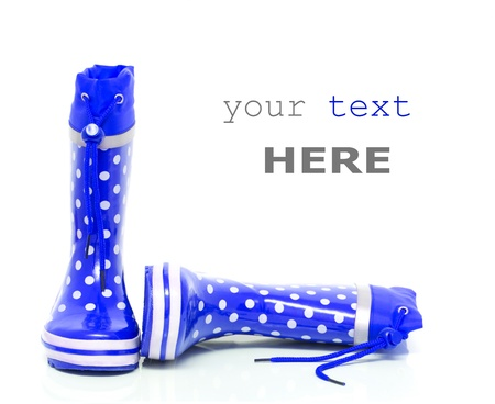 wellie: Blue rubber boots for kids isolated on white background (with space for text)