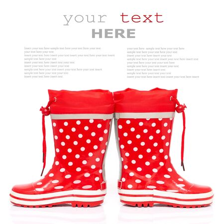 Red rubber boots for kids isolated on white background (with sample text) photo