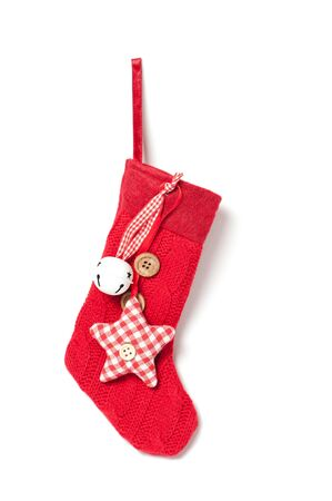 Red Christmas stocking hanging on white background photo