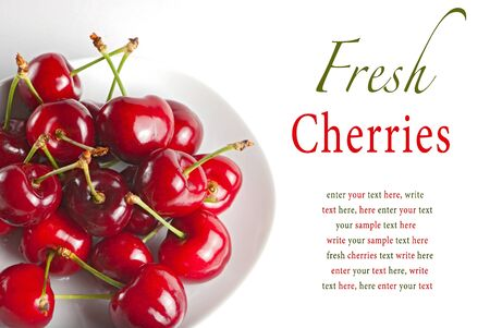 Fresh cherry berries on white plate with sample text photo