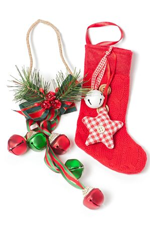 Red Christmas stocking with jingle bells photo
