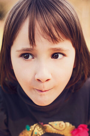 Girl with funny facial expression Stock Photo