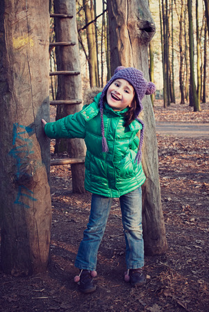 Beautiful girl playing in playground area photo