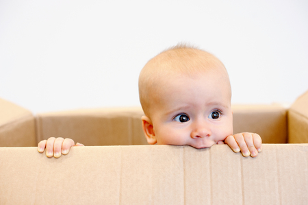 Baby todler in a carton box dreaming Stock Photo - 60392097