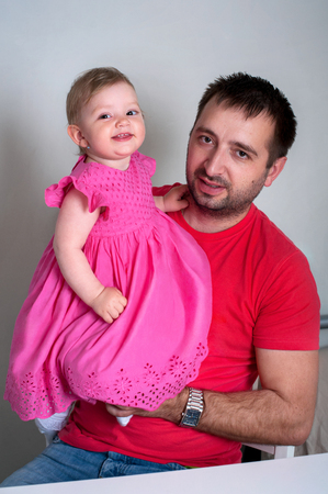 Father and daughter. Happy young father holding his smiling daughter Stock Photo