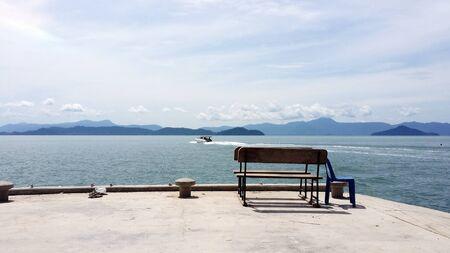 empty chairs on harbor