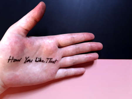 One open hand with sentence 'How You Like That' on black and pink background 写真素材
