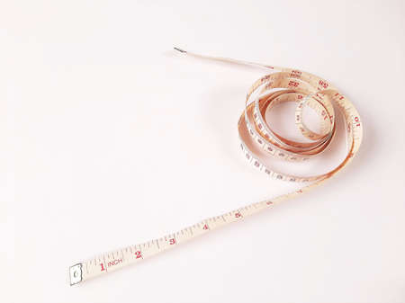 Tape measure coil on white background - copy space 版權商用圖片