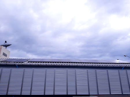 Solar cell panels on building roof with blue sky on background. Nobody. Stock fotó