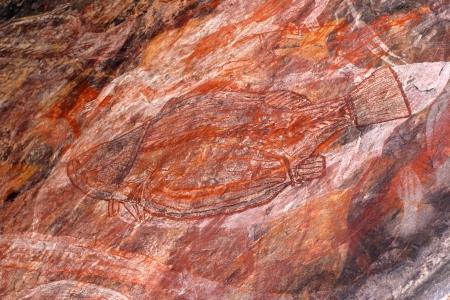 aborigines: Aboriginal rock art of the Gagudju people of Northern Australia, one of the oldest continuing cultures on the planet  This art is between 5,000 and 15,000 years old Stock Photo
