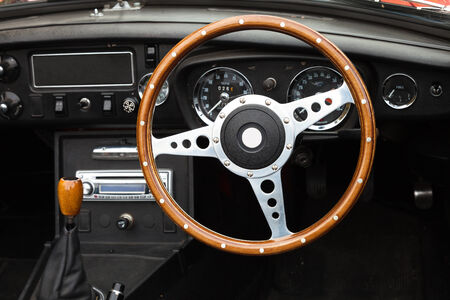 vintage cars: Wooden steering wheel from a Classic MGB roadster sports car Stock Photo