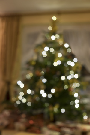 french doors: Decorated christmas tree in a home in the lounge the lights are on creating a bokeh effect. Stock Photo