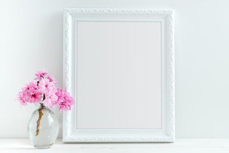 White portrait decorative frame Mock-up. Overlay your text or design onto the frame, perfect for social media campaigns. Stock Photo