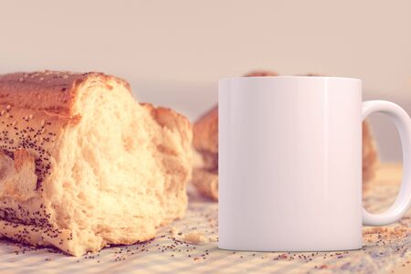 White blank coffee mug mock up, in front of a loaf of bread, add custom design or quote on to the mug.
