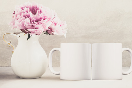2 Mug Mockup Floral styled stock photograph, ready for you to add your own design or quote on to. Stock Photo