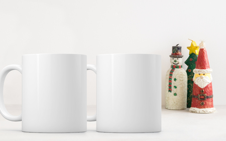 Two white blank coffee mugs Christmas theme mock up to add custom design or quote.