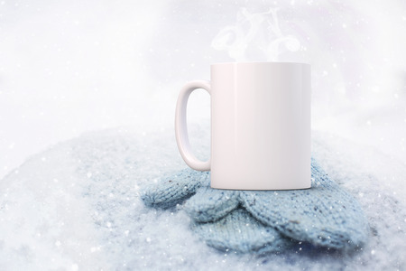 White blank coffee mug Winter theme mock up to add custom design or quote.. Perfect for businesses selling mugs, just overlay your quote or design on to the image. Perfect for businesses selling mugs. Stock Photo